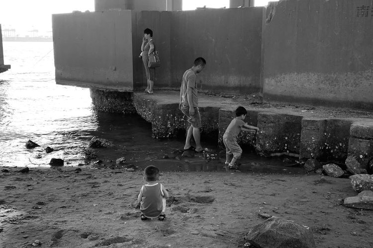 Full length of children playing in water