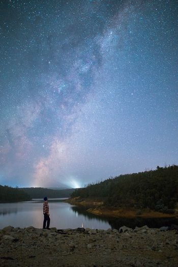 Star - Space Night Sky Space Water Astronomy Galaxy One Person Beauty In Nature Scenics - Nature Nature Adult Tranquility Milky Way Standing Star Field Lake Space And Astronomy Outdoors