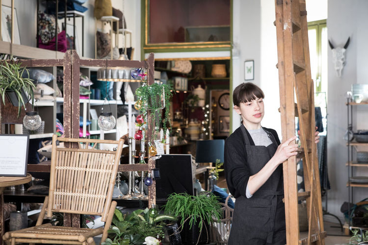 Portrait of woman standing at store
