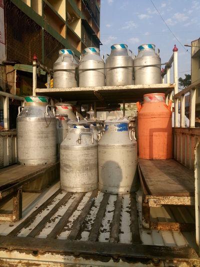 Metallic milk jugs on pick-up truck