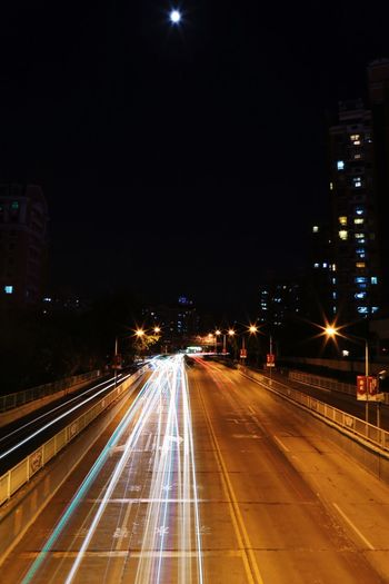 Illuminated Night Speed Light Trail Motion Transportation Road Street Light Street Long Exposure High Street City Blurred Motion Building Exterior Built Structure Architecture Outdoors No People The Week On EyeEm High Angle View