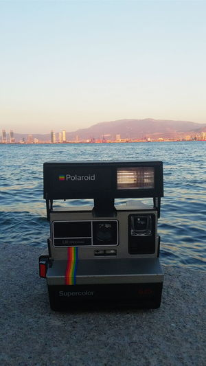 Poloroid Poloroid Camera Poloroidpicture Camera Sea Water Blue Water Clear Sky Copy Space Blue Sea Waterfront Outdoors Engineering Tranquility No People Capital Cities