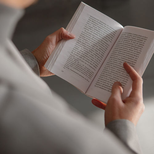 High angle view of man reading book on paper