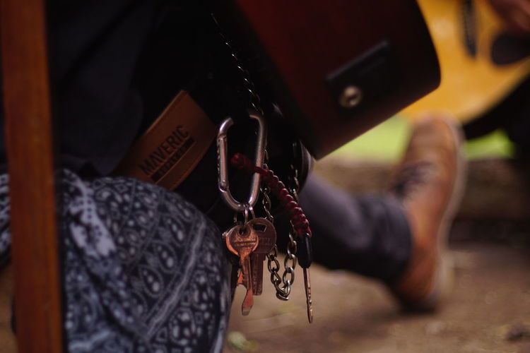 Close-up of hand holding chain hanging