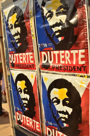Posters of presidential candidate Rodrigo Duterte during the final election debate held at University of Pangasinan in DAgupan City. Drugs Philippines Rodrigo Duterte Campaign Campaign Signs Closed Fist Davao City Election Expletives Extra Judicial Killings Flag Posters Presidential Election 2016 Tokhang
