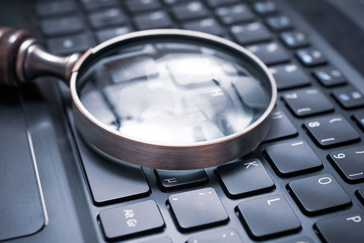 Close-up of magnifying glass on laptop