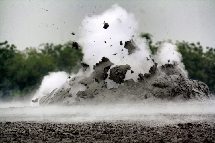 Mud Crater Eruption close up Beauty In Nature Dirt Environment Glass - Material Land Nature Non-urban Scene Outdoors Power In Nature Sky Smoke - Physical Structure Volcano Water