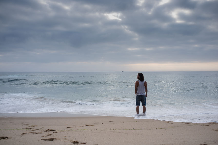 Guy watching the ocean in beautiful cloudy scenery Atlantic Ocean Beauty In Nature Cloud - Sky Dreaming Hope Horizon Over Water Idyllic Leisure Activity Lifestyles Nature Outdoors Portugal Remote Scenics Sea Shore Traces Tranquil Scene Tranquility Vacations Watching The Horizon