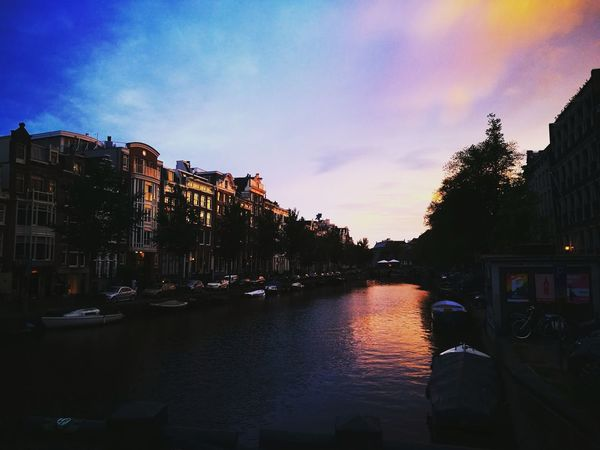 Reflection Water Outdoors Sky Architecture No People Night City City Building Exterior Illuminated Amsterdam Holland Personal Perspective Sunset Nature Skyporn Sky Vacations Trip Travel Lost In The Landscape Perspectives On Nature