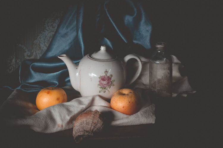 Still life Food And Drink Healthy Eating Food Wellbeing Freshness Indoors  Fruit Still Life Drink Orange Color Citrus Fruit Cup Orange Orange - Fruit Textile Table Refreshment No People Teapot High Angle View Black Background Tea Cup Tray Still Life Photography