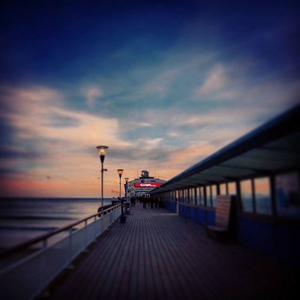 """ The Pier "" Bournemouth Bournemouthpier Bournemouthbeach Pier Sunset Sunsetsofinstagram Dusk Seashore Seaview Cloudsoftheday Cloudsofinstagram Skyscene Englishchannel Perspective Vanishingpoint"