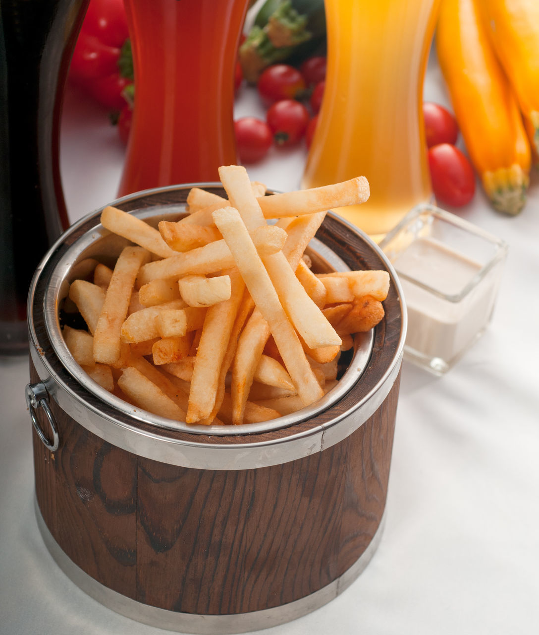 High Angle View Of French Fries In Container With Juices