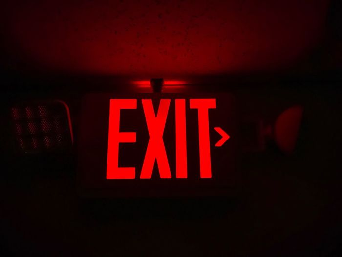 Safety Exit Illuminated Red Text Communication Sign Western Script No People Exit Sign Guidance Indoors  Night Lighting Equipment Neon Glowing Capital Letter