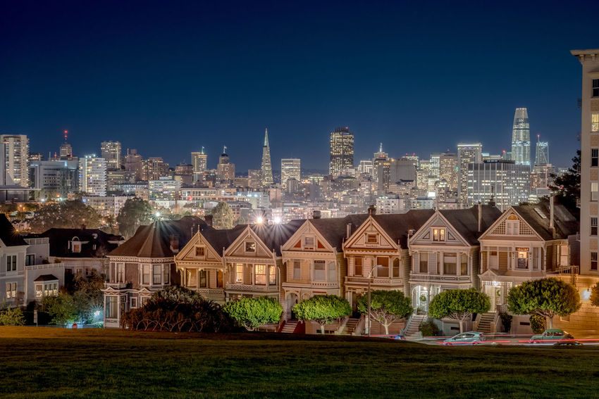 "The famous row of Victorian houses called ""Painted Ladies"" in San Francisco. This photo was taken at night and shows the skyline in the background. Alamo Square City Life Downtown Financial District  Night Photography Painted Ladies San Francisco San Francisco San Francisco, California Skyline Architecture Building Exterior Built Structure City City Lights Cityscape Downtown District Night No People Outdoors Painted Ladies San Francisco Bay San Francisco Skyline Sky Skyscraper Urban Skyline"