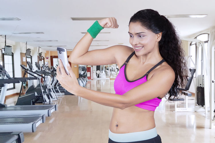 Confident woman exercising in gym