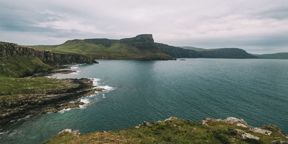 Scenic view of neist point against cloudy sky