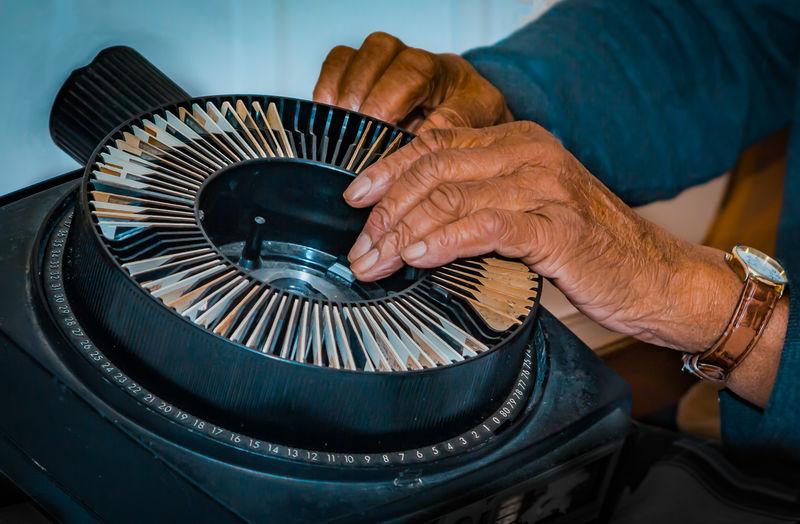 Close-Up Of Hands Repairing Equipment