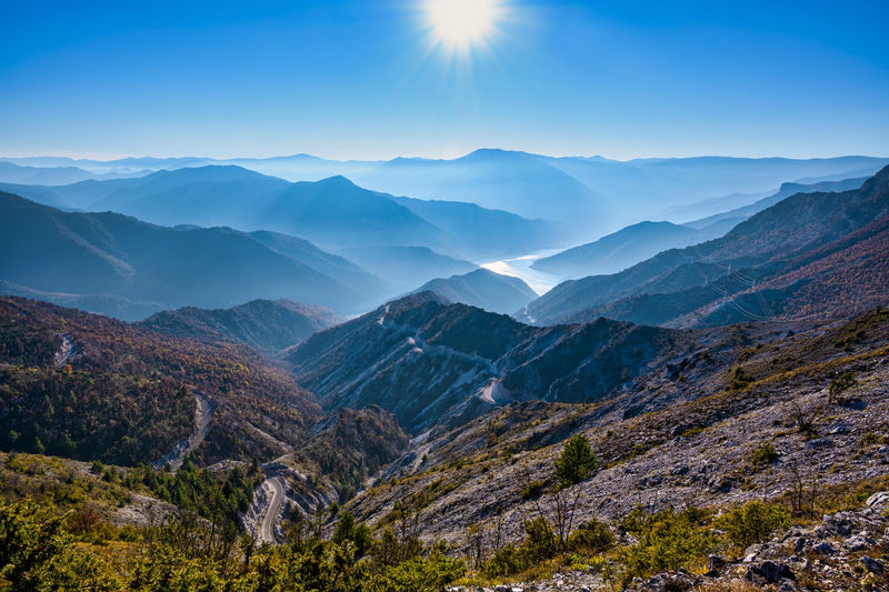 Scenic view of mountains against sky amd sun
