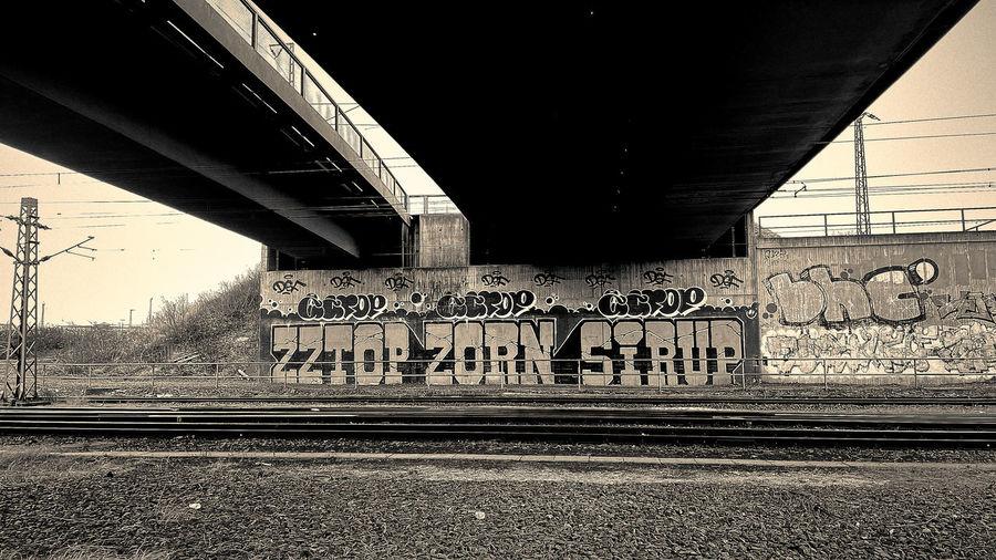 Graffiti on bridge at railroad tracks