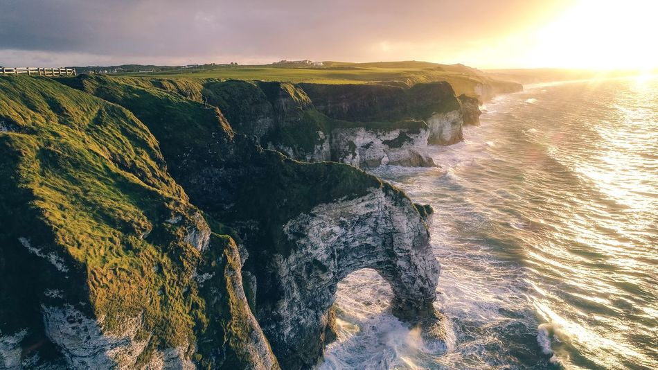 Beautiful sunset at the Causeway Road Landscape Nature Northern Ireland Landscape Beauty In Nature Sky Scenics - Nature Tranquility Nature Sunlight Sunset Environment Tranquil Scene Land Landscape No People Outdoors Idyllic Non-urban Scene Mountain Sea Water Cloud - Sky High Angle View