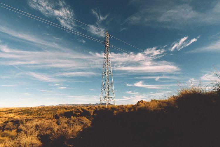 Electricity Pylon On Landscape Against The Sky