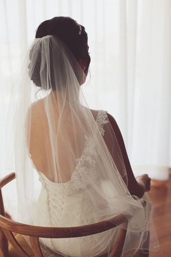 Rear View Of Bride Sitting On Chair