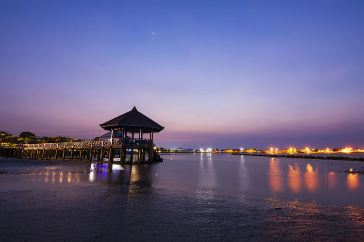 beautiful blue hour sunset beauty in Nature Blue Hour sunset landscape Nature Discover Your City Adventure Beauty In Nature Blue Hour Sunset Landscape Nature ASIA Central Java Nikon Colorful INDONESIA Beach Travel EyeEm Selects Water Sunset Sea Illuminated Blue Beach Reflection Sky Architecture Horizon Over Water Pavilion Seascape Coast Calm Gazebo Tide My Best Travel Photo