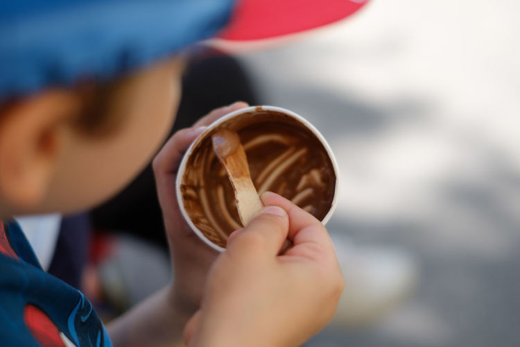 Blurry Background Boys Childhood Choccolate Close-up Day Eating Ice Cream Focus On Foreground Focus On Ice C Food And Drink Freshness Headshot Holding Human Hand Ice Cream Kids Playing Little Boy One Boy Only One Person Outdoors People Real People Selective Focus Wood Spoon