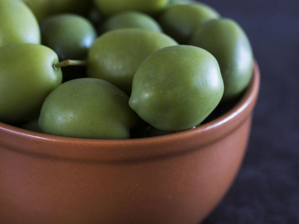 Cup full of green olives. Selective focus Close-up Cup Day Focus Food Food And Drink Freshness Fruit Full Granny Smith Apple Green Green Color Green Color Green Olive Healthy Eating Indoors  No People Olives Slelective Sour Taste