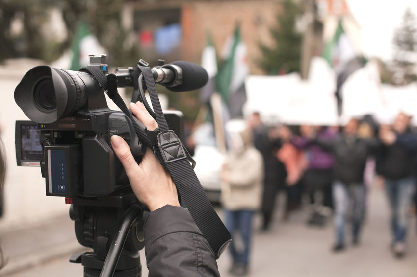 Filming street protest using video camera Camera Man Camera Operator CameraMan Event Press Protest Broadcasting Journalism Camera Operator Covering Demonstration Filming Footage  Holding Human Hand Media News Outdoors People Protesters Protesting Street Street Protest Tv Broadcasting Video Video Camera