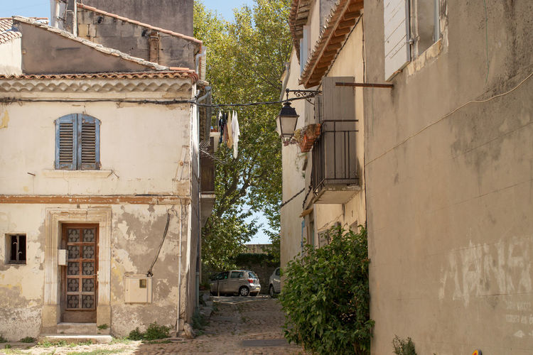 A narrow street at Arles,France Alley Architecture Building Exterior Built Structure City Life Day Footpath Long Narrow No People Outdoors Residential Building Residential Structure Street The Way Forward Town Window