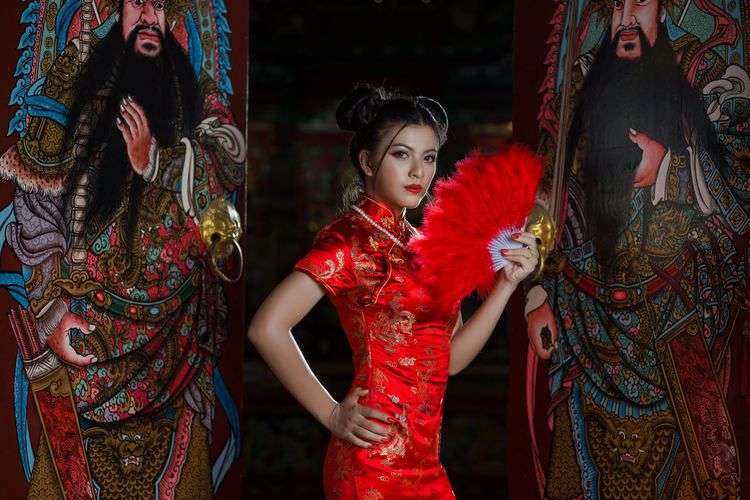 Chinese girl in red dress Stand in Chinese court Chinese Food Dress Portrait Of A Woman Traditional Clothing Year Of Photography 2015 Beauty Chinese Chinese New Year Chiness Style Chiness Temple Culture God Temple Holy Indoors  Lifestyles One Person Portrait Real People Red Standing Traditional Traditional Costume Year Young Adult Young Women
