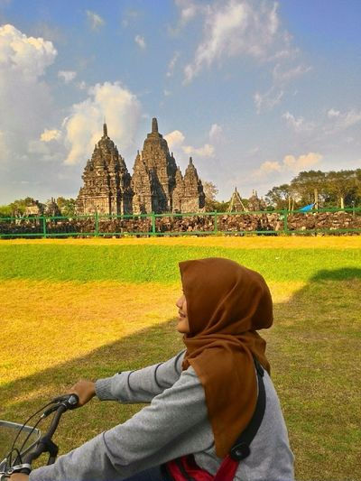 PrambananTemple Religion Spirituality Travel Destinations One Person Architecture Full Length Outdoors Tranquil Scene People Adult Adults Only Day Sky Clear Sky Grass Beauty In Nature Nature