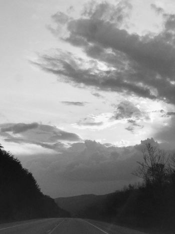 Tree Sky Nature Cloud - Sky Landscape Scenics Tranquil Scene Tranquility Beauty In Nature No People Day Road Outdoors Silhouette Mountain