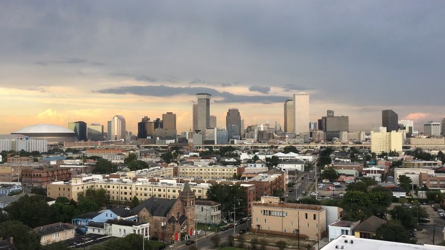 New Orleans, Louisiana skyline at sunset Cityscape Louisiana Mardi Gras New Orleans, LA Dawn Dusk Hurricane Skyscraper Storm Cloud Sunset Superdome