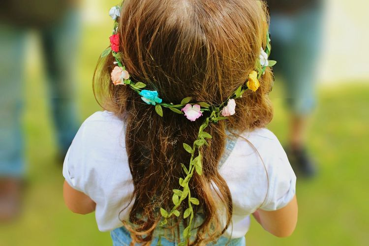 Rear view of flower garland in girl's hair
