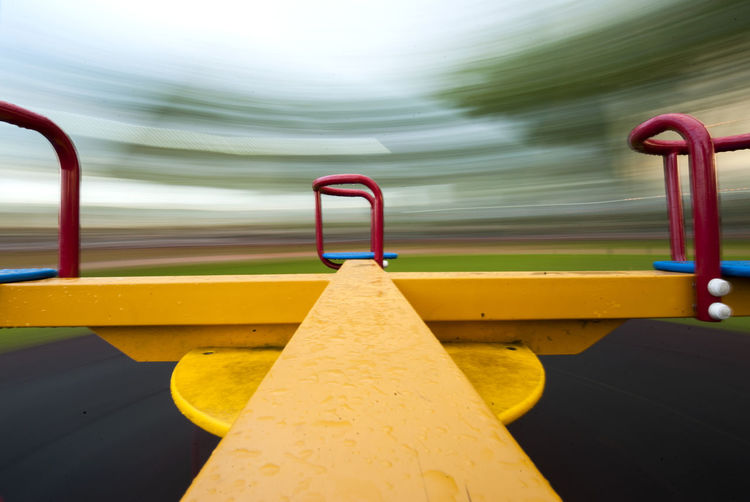Close-up of yellow playground against blurred background