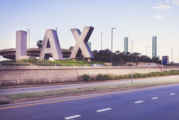 LAX airport Airport Architecture Built Structure California Clear Sky Communication Day Industry LAX Letters Long Losangeles No People Outdoors Road Sky Solitude Street Sunset Tall - High Transportation USA Warm Colors