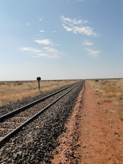 Namibia Cloud - Sky Day Diminishing Perspective Grass Landscape Nature No People Outdoors Rail Transportation Railroad Track Railway Track Scenics Sky The Way Forward Transportation W-namibia Infinité Infinite Width Endless
