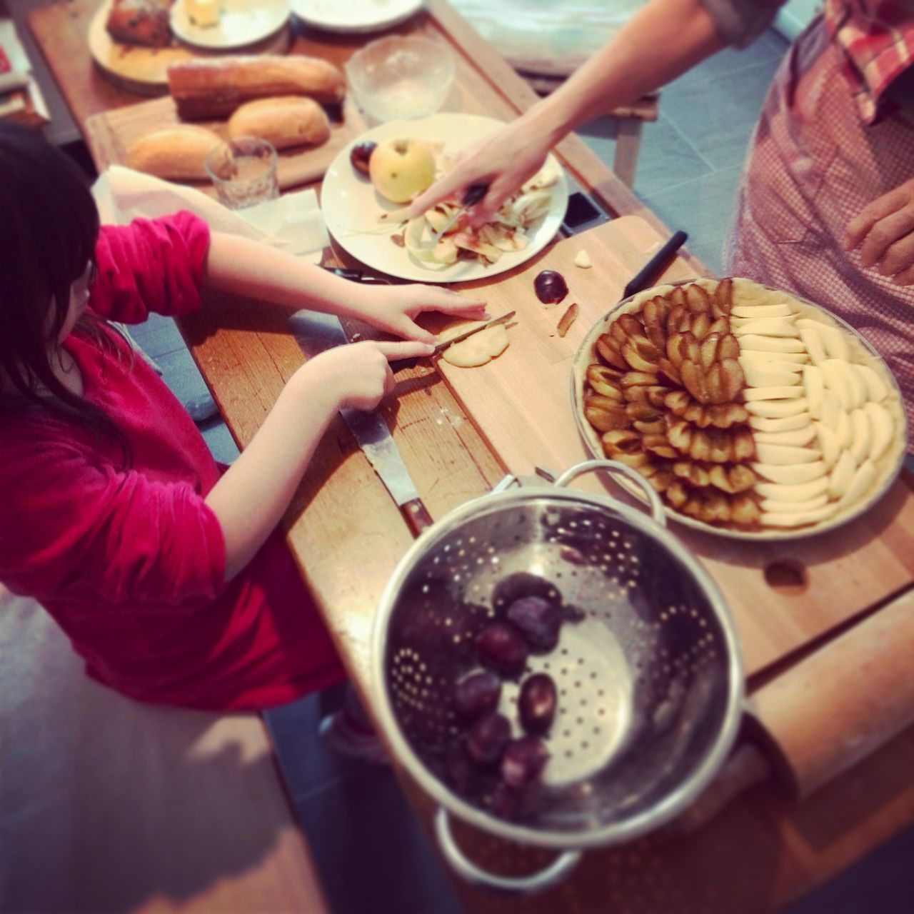 Family baking cake in domestic kitchen
