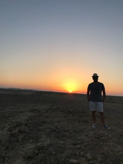 Desert Sky Sunset Real People Land One Person Beauty In Nature Scenics - Nature Standing Beach Tranquility Men Lifestyles Tranquil Scene Copy Space Nature Outdoors Rear View Full Length Leisure Activity Orange Color My Best Travel Photo