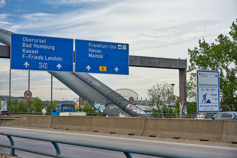 Information sign on metal against sky