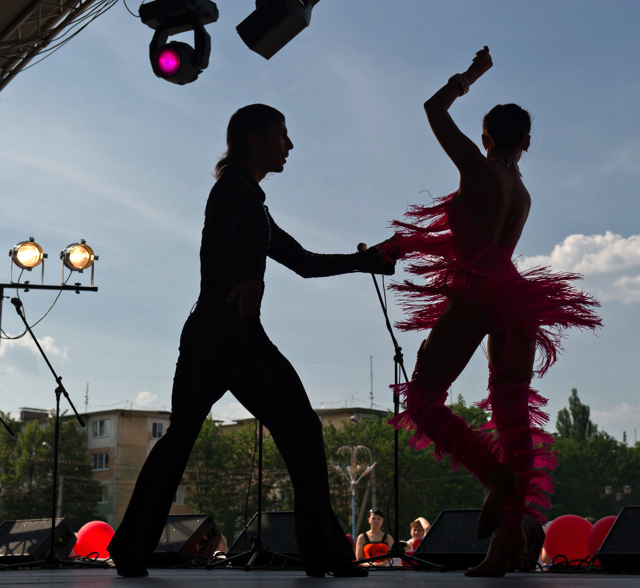 dancing, performance, dancer, leisure activity, skill, sky, real people, lifestyles, arts culture and entertainment, men, women, enjoyment, full length, motion, low angle view, outdoors, togetherness, stunt, day, architecture, city, people