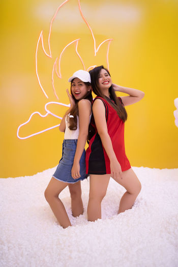 beautiful asian playing at styrofoam pool Two People Young Women Smiling Emotion Young Adult Happiness Love Togetherness Women Full Length Lifestyles Looking At Camera Front View Positive Emotion Leisure Activity Couple - Relationship People Portrait Clothing Adult