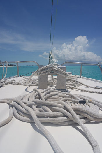 Rope on deck of boat with sea in background