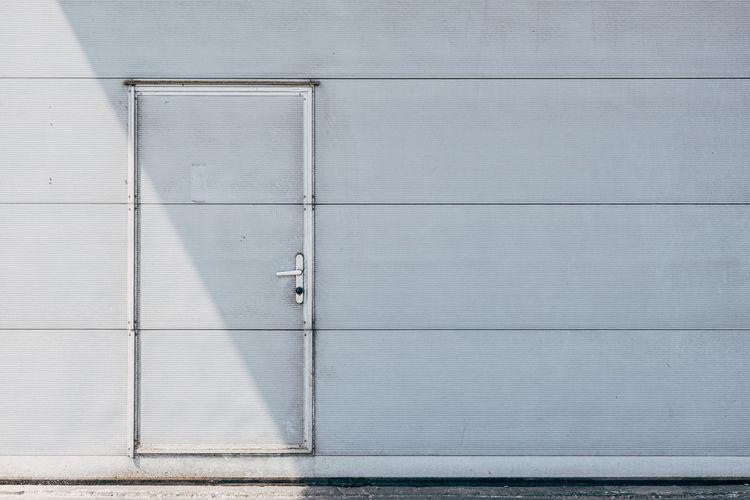 Closed metal door in metal wall