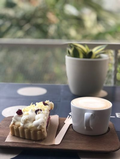 Close-up of coffee cup and cake on table