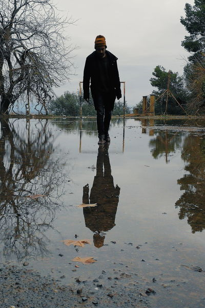 look into yourselves. Water Reflection Working Men Full Length People One Person Puddle Outdoors Day