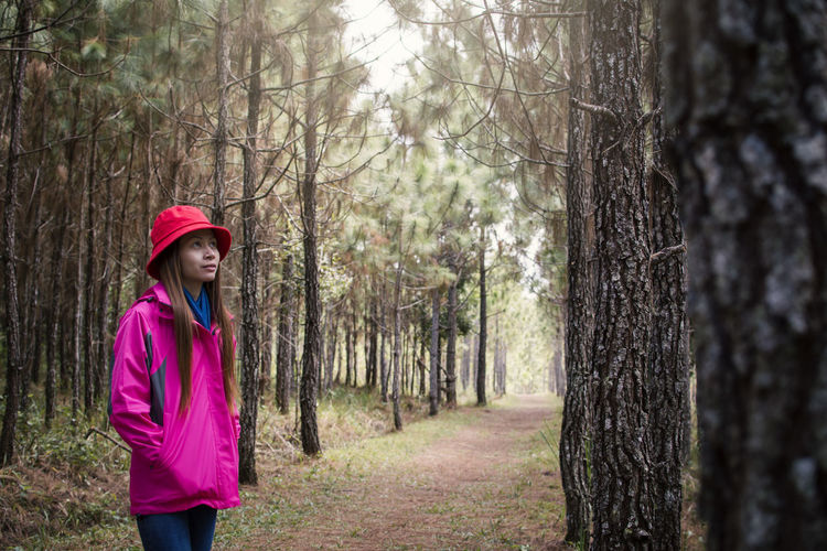 Woman Standing Amidst Trees