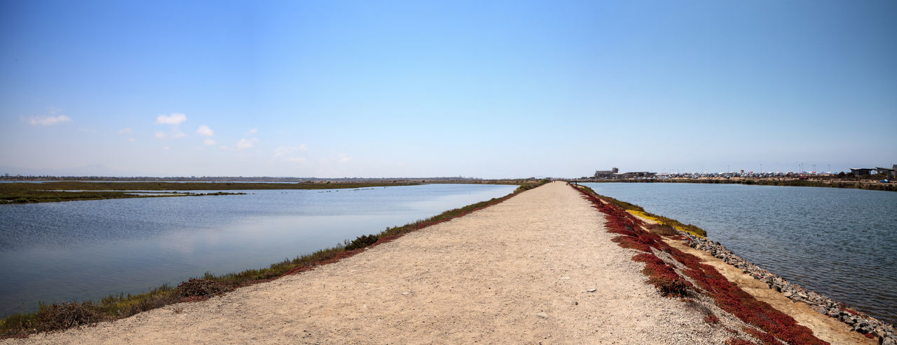 Path along the peaceful and tranquil marsh of Bolsa Chica wetlands in Huntington Beach, California, USA Bolsa Chica Bolsa Chica Nature Preserve California Coastline Huntington Beach Marsh Nature Orange County, Ca Wetland Bolsa Chica Wetlands Coast Flying Bird Great Egret Lake Landscape Water